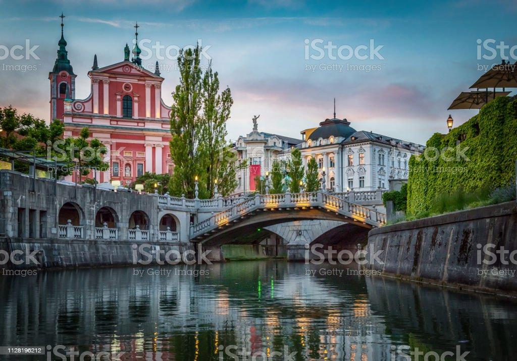Tromostovje bridge and Ljubljanica river in the city center. Ljubljana, capital of Slovenia. stock photo