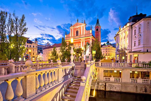 Tromostovje bridge in Ljubljana evening view Tromostovje bridge and square evening view, Ljubljana, capital of Slovenia ljubljana stock pictures, royalty-free photos & images