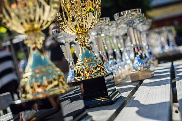 trophies - awards ceremony stock photos and pictures