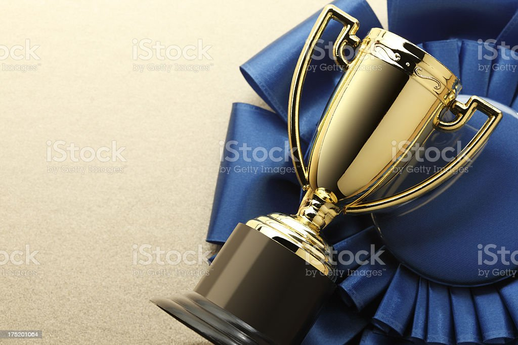 Trophy and Blue Ribbon stock photo