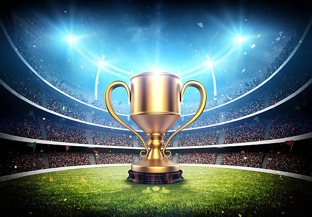 trophy cup in the stadium - sportkampioenschap stockfoto's en -beelden