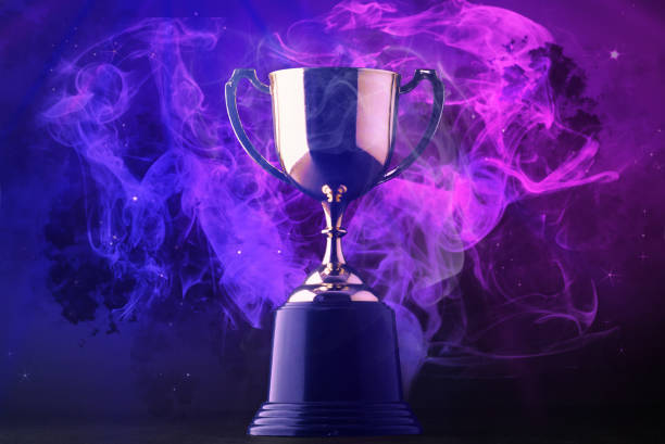 Trophy on smoke on dark blue futuristic background for e-sport winner concept. Trophy on smoke on dark blue futuristic background for e-sport winner concept. win stock pictures, royalty-free photos & images