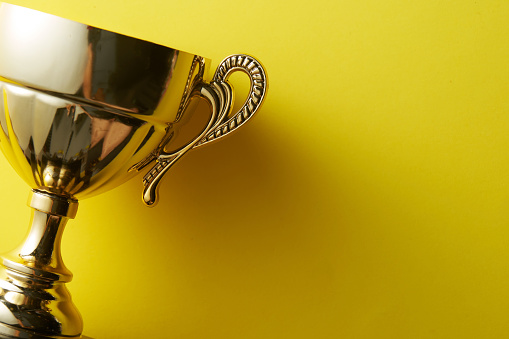trophy on the yellow color background