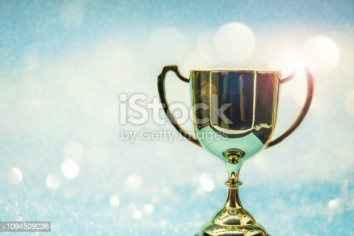 istock trophy over wooden table and background bokeh. 1094509236