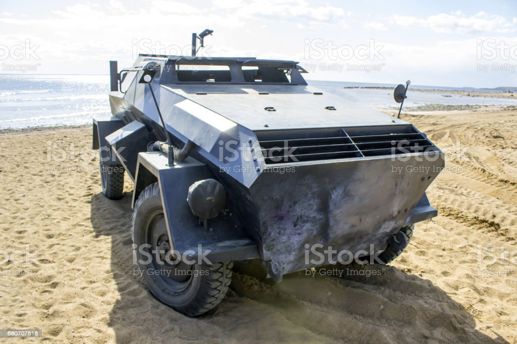Trophy war machine of the period of World War II on the beach near the sea stock photo
