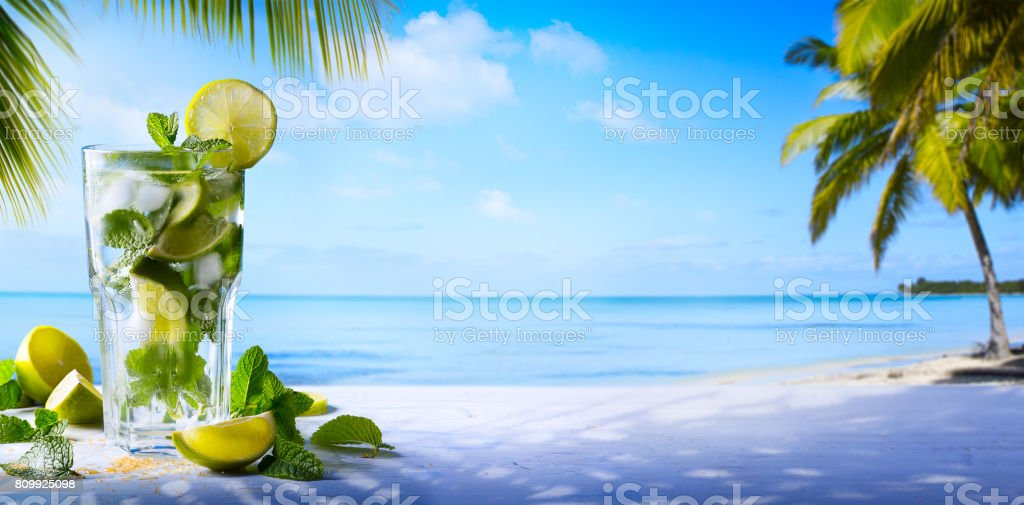tropic summer vacation; Exotic drinks on blur tropical beach background stock photo