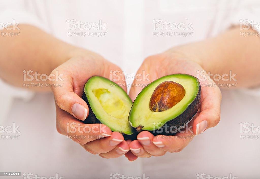 Tropical Avocado Sliced in Half stock photo
