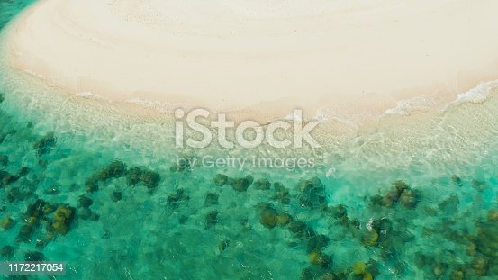 1143575463 istock photo Tropical beach and blue sea with waves 1172217054