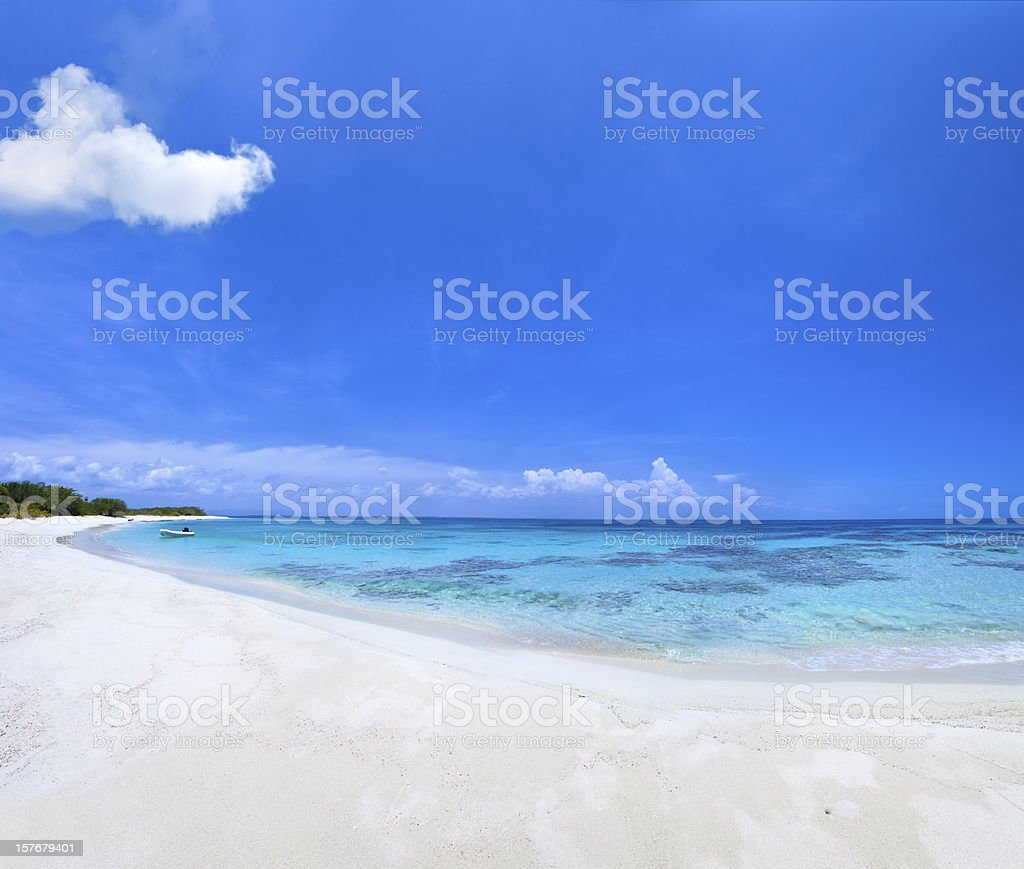 Tropical beach and cloudy deep blue sky royalty-free stock photo