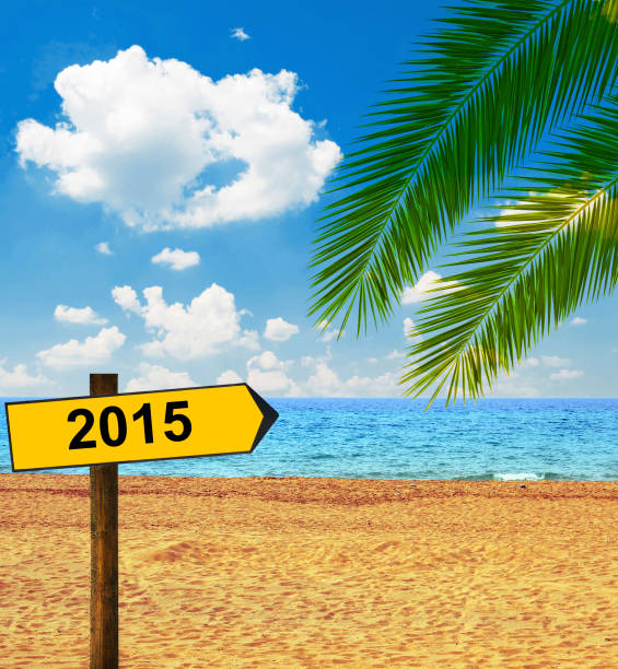Tropical beach and direction board saying 2015 Tropical beach and direction board saying 2015 reveillon stock pictures, royalty-free photos & images
