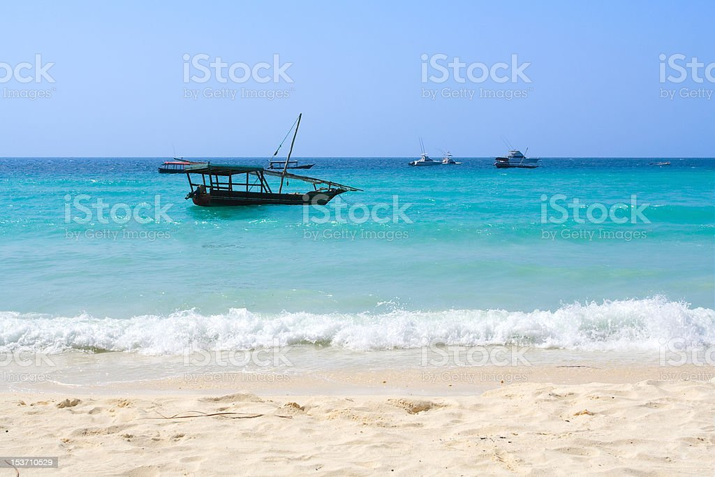 tropical beach and fishing boat stock photo