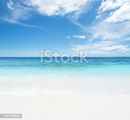 Tropical beach and seascape with blue sky background