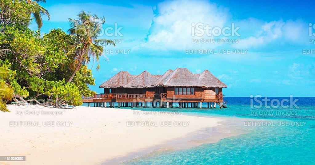 Tropical beach at Bandos island in Maldives stock photo