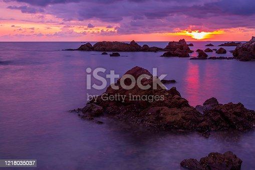 511675552 istock photo Tropical beach at beautiful sunset. Nature background 1218035037