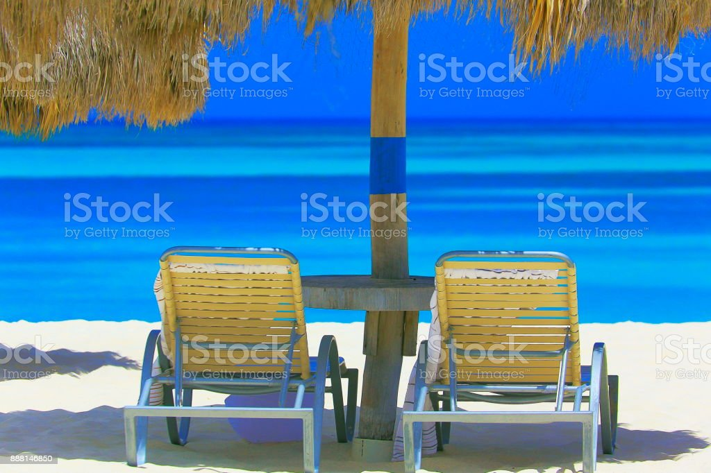 Tropical Beach in Aruba with beach chairs and thatched roof palapa shadow,  turquoise lagoon, summer paradise – Dutch Antilles, Caribbean sea stock photo