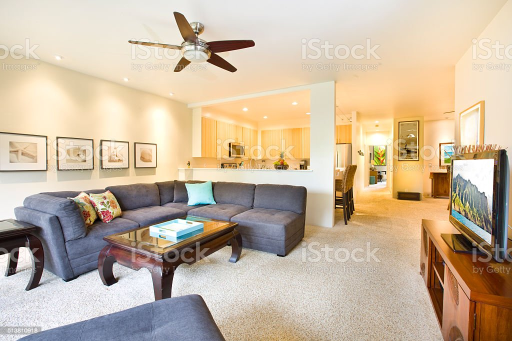 Tropical Beach Themed Condominium Apartment Living Room and Kitchen stock photo