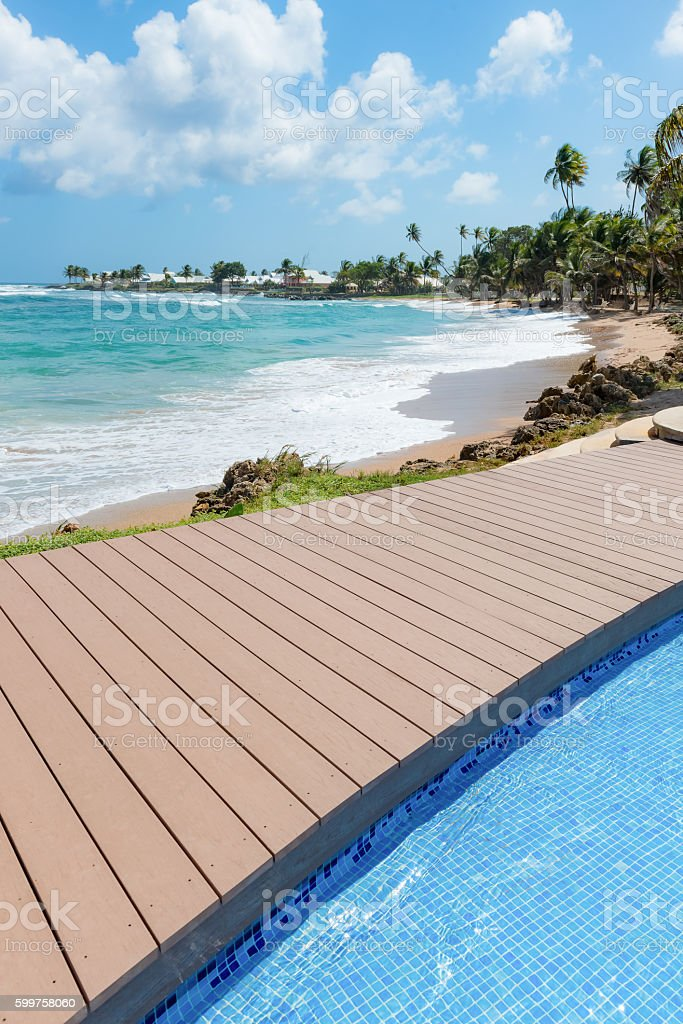 Tropical beach Tobago Caribbean nearby pool and wooden deck stock photo