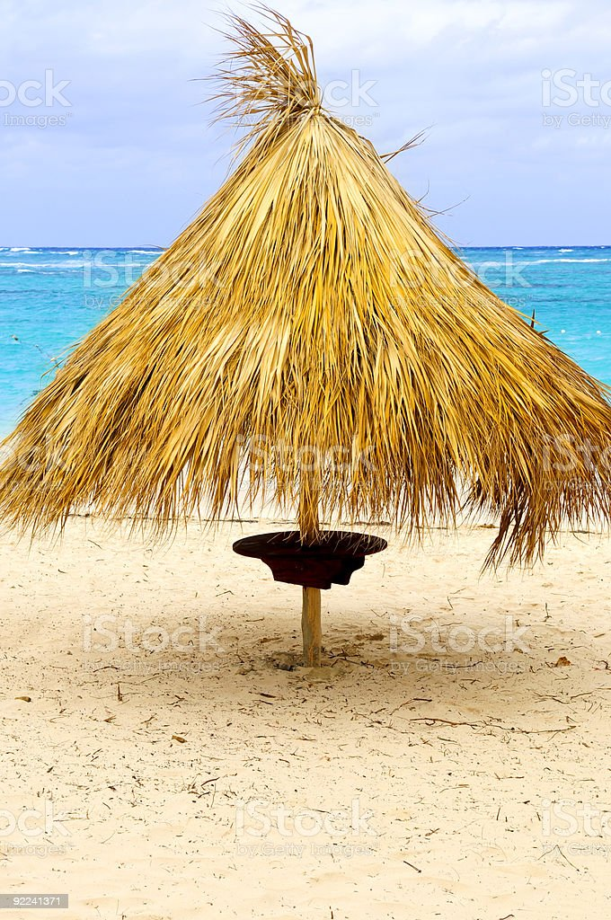 Tropical beach umbrella royalty-free stock photo