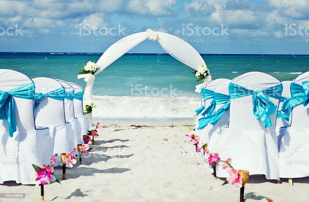 Tropical beach wedding facing the ocean royalty-free stock photo