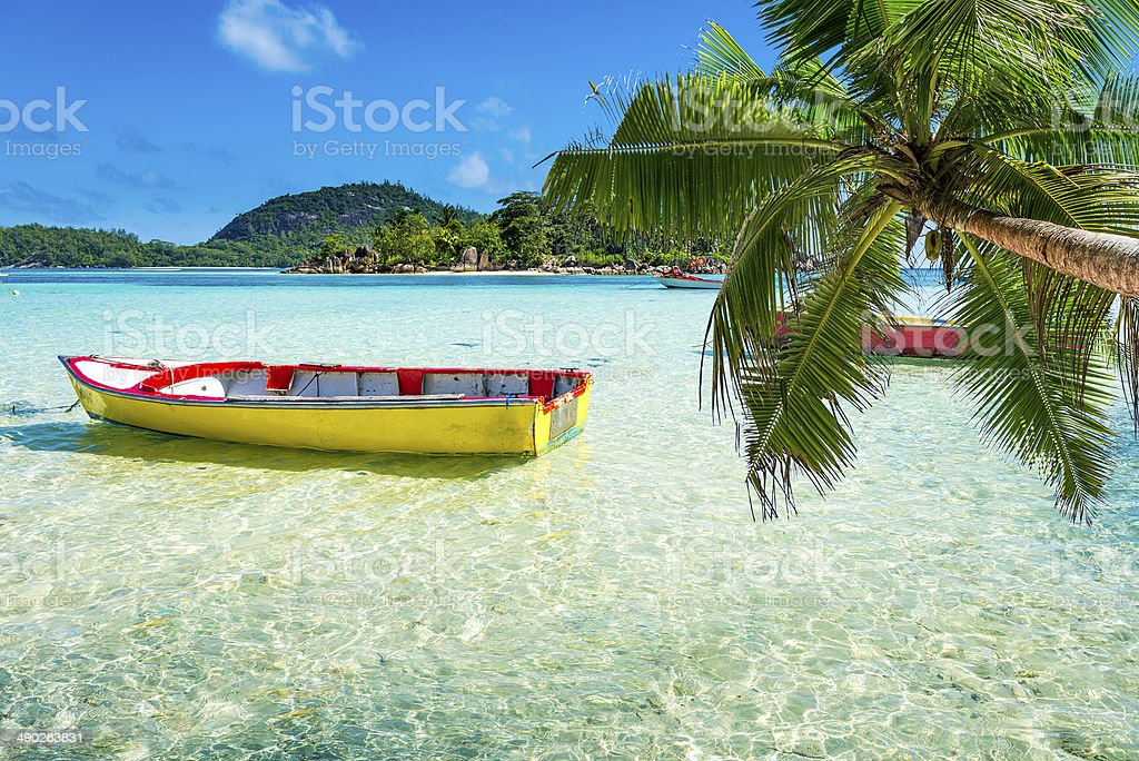 tropical beach with a boat stock photo