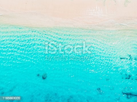 istock Tropical beach with blue crystal ocean. Aerial view 1165663020