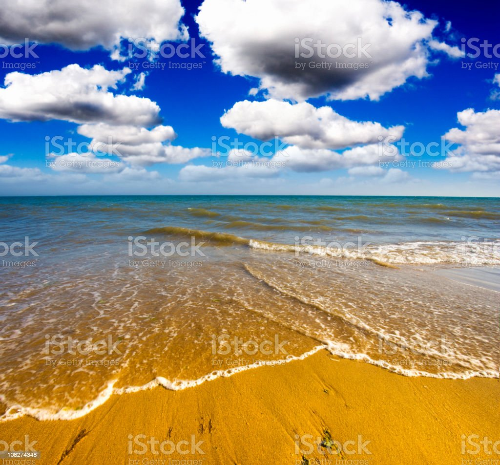Tropical Beach with Blue Sky and White Clouds royalty-free stock photo