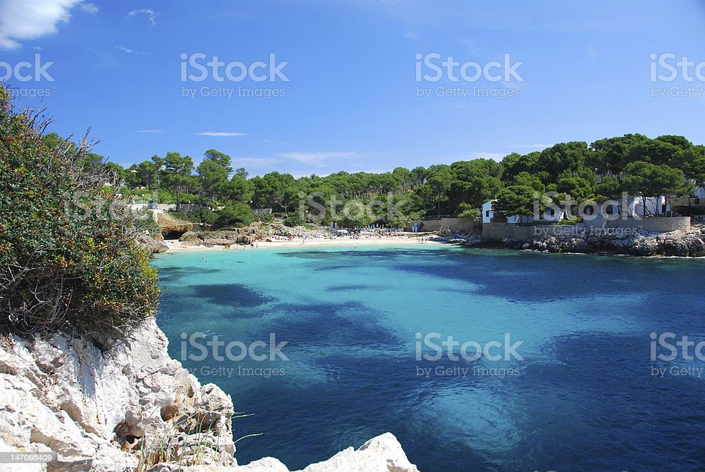 Tropical beach with blue water at Mallorca royalty-free stock photo