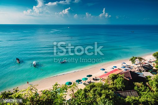 Tropical beach with boats and blue ocean in tropical island