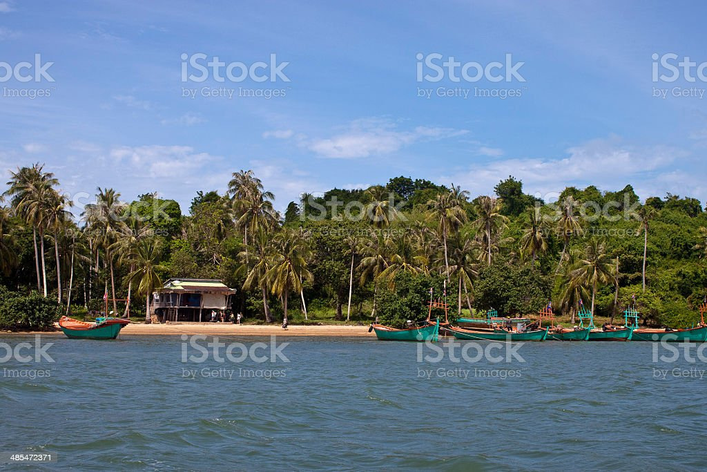 Tropical beach with boats on Koh Tonsay island stock photo