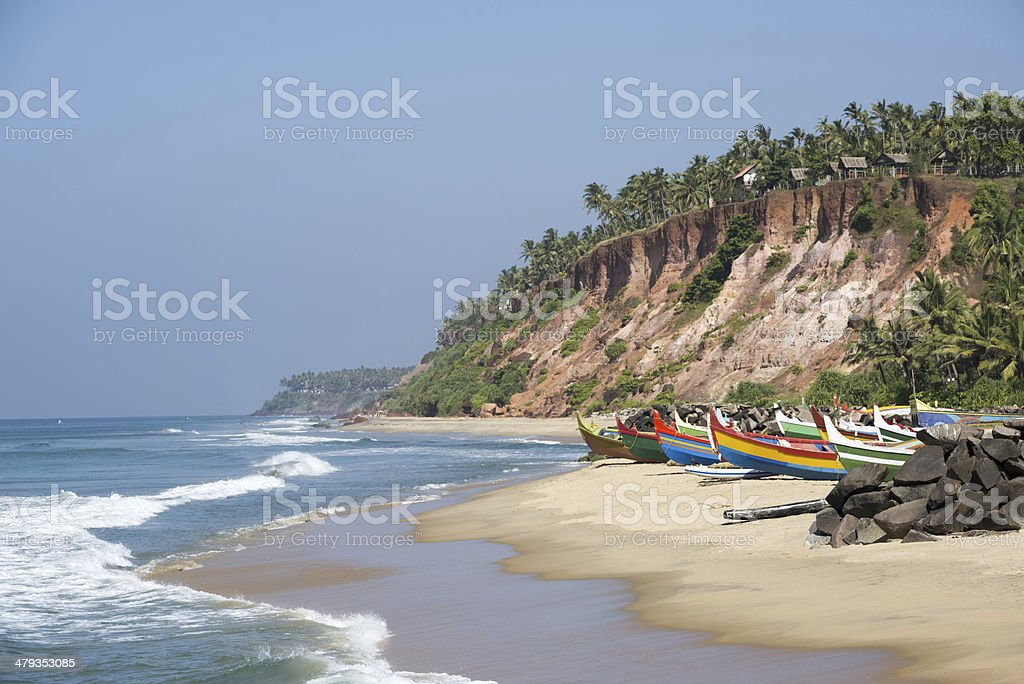 Tropical beach with fishing boats stock photo