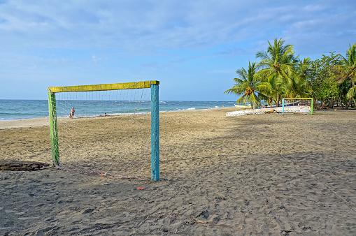 Tropical beach with football goal