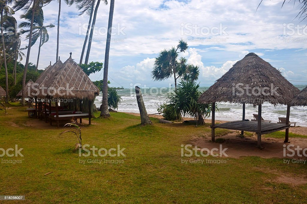 Tropical beach with huts on Koh Tonsay island stock photo