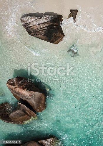 999001484 istock photo Tropical Beach with lagoon and Rocks 1204443414