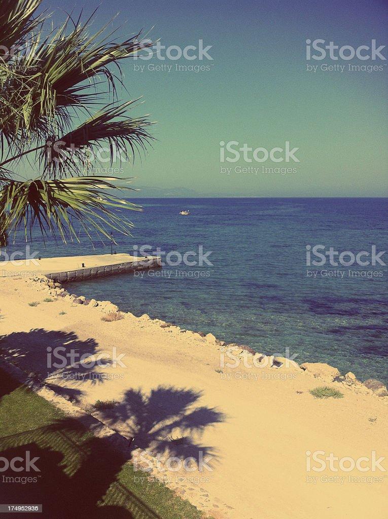 Tropical beach with palms, Kalem Island, Izmir, Turkey royalty-free stock photo