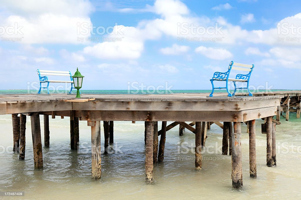 Tropical beach with pier royalty-free stock photo