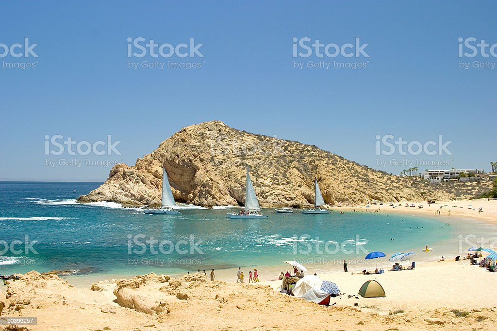 Tropical Beach with Sailboats stock photo