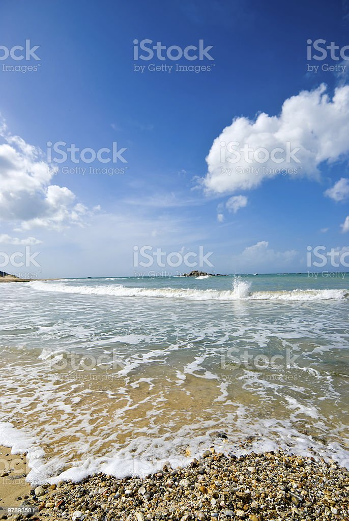 Tropical beach with sand and pebbles royalty-free stock photo