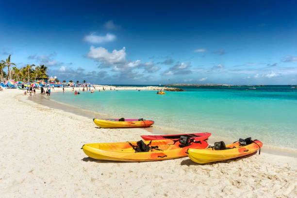Tropical beach with turquoise water and kayaks. Caribbean sea stock photo