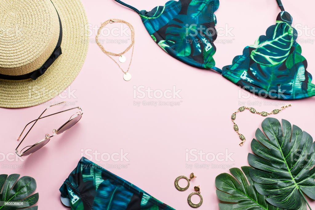 a671310c Tropical bikini swimsuit, beach fashion. Traveler woman accessories flat lay  with swimwear, palm