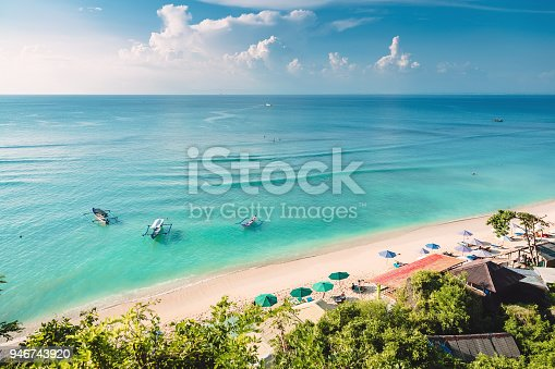 istock Tropical blue ocean, sandy beach and boats in Indonesia, Bali 946743920