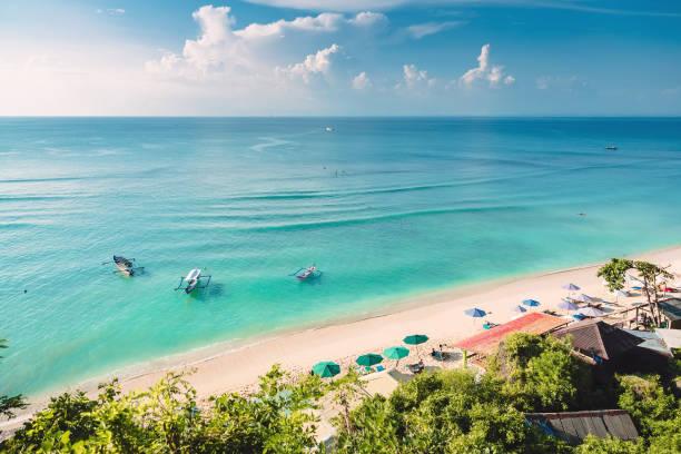 Tropical blue ocean sandy beach and boats in indonesia bali picture id946743920?b=1&k=6&m=946743920&s=612x612&w=0&h=xw7a5hj9pech8gimxh0q7mtys rkk22yekxy8dcqqlq=