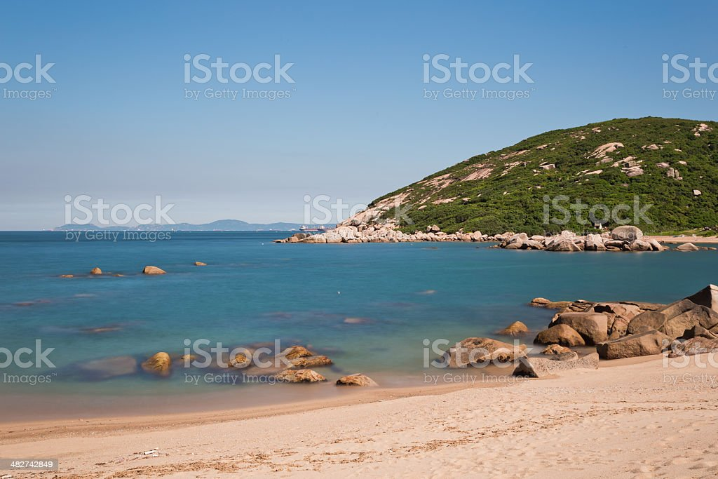 Tropical blue sand beach stock photo