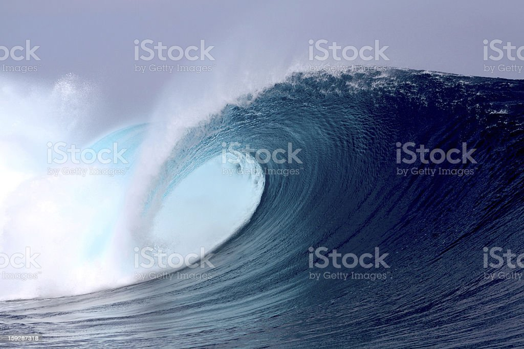 Tropical blue surfing wave stock photo