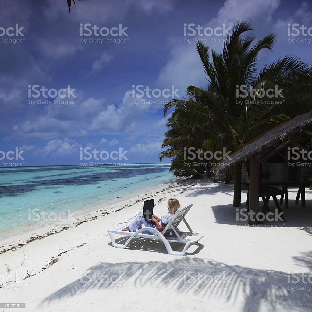 tropical business woman with laptop royalty-free stock photo