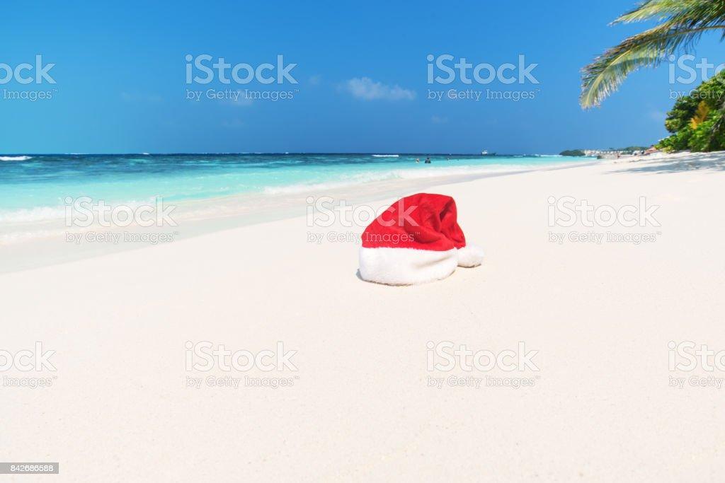 Santa hat on the tropical beach