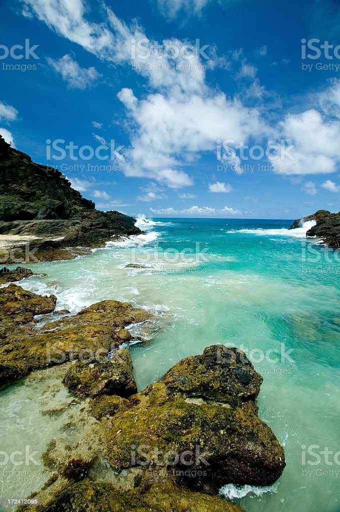 Tropical coastline under a blue sky with white clouds royalty-free stock photo