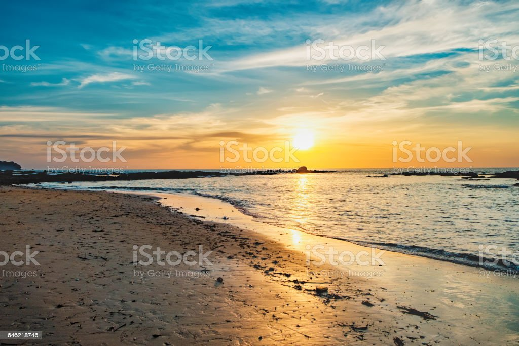 Tropical colorful dramatic sunset with cloudy sky stock photo