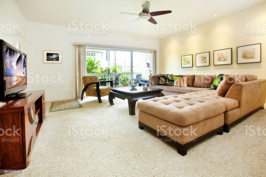 Tropical Condo Open Concept Living Room With Kitchen Stock Photo