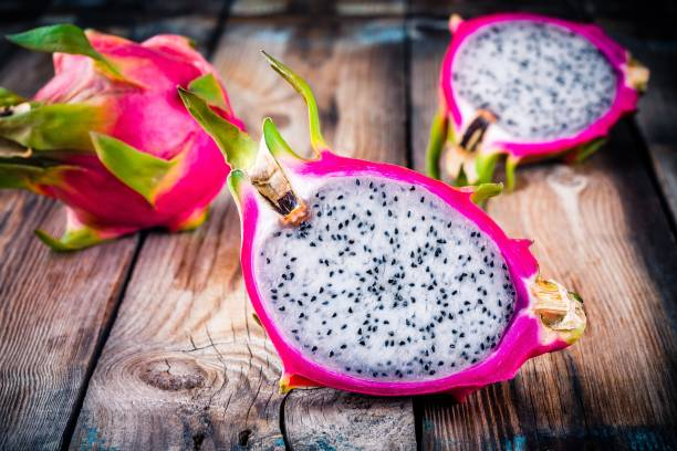 Tropical dragon fruit or pitaya Tropical dragon fruit or pitaya on wooden rustic background pitaya stock pictures, royalty-free photos & images