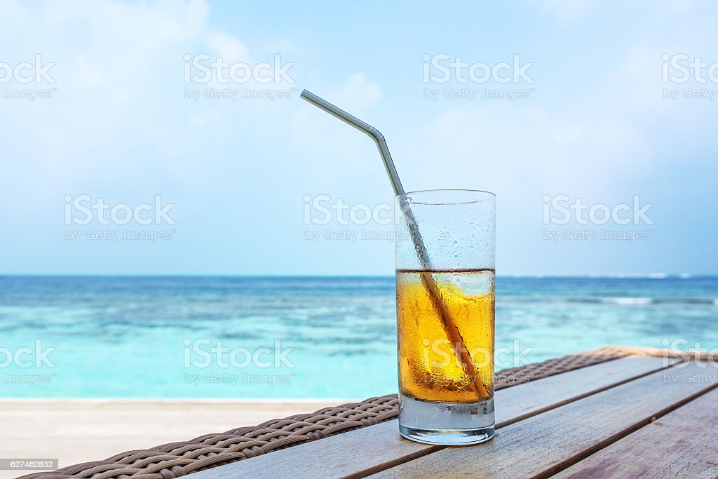 Tropical drink on table near the sea stock photo